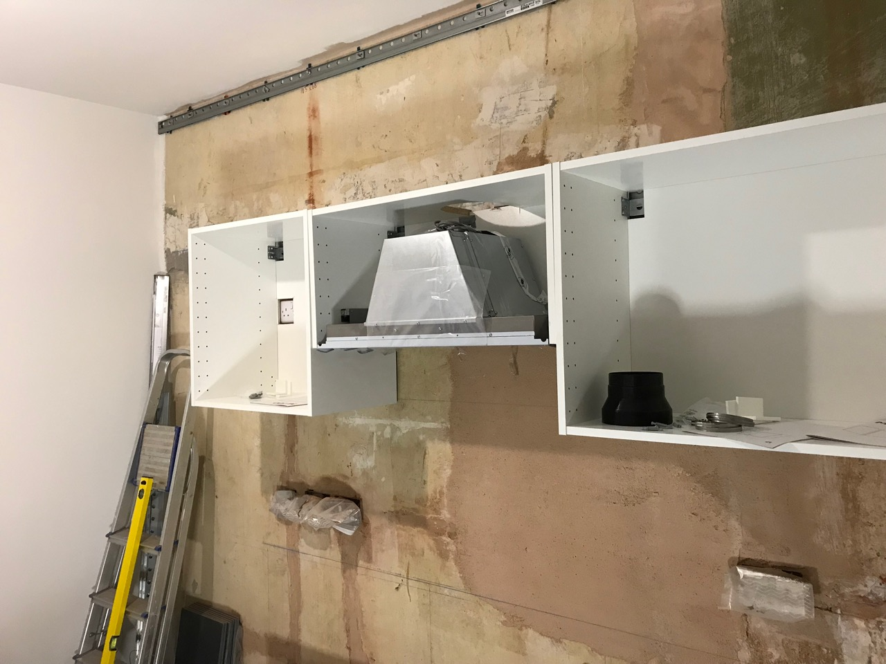 Three fitted cabinets with extractor fan